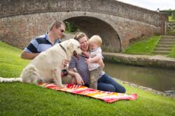a family enjoy time by canal